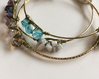 Glass bead and howlite wire wrapped gold bangles.