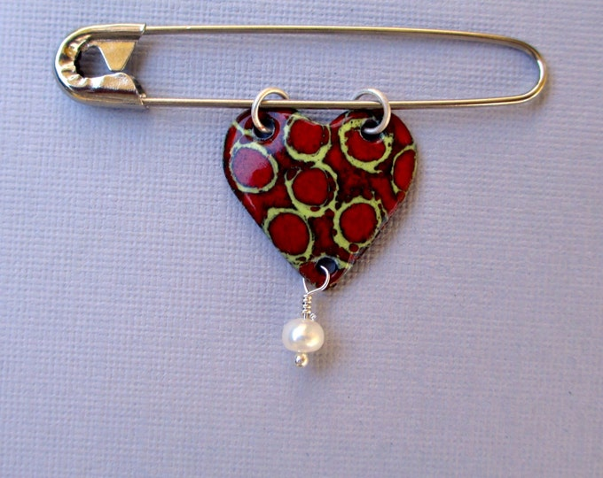 Enameled yellow and red heart with a freshwater pearl on a safety pin