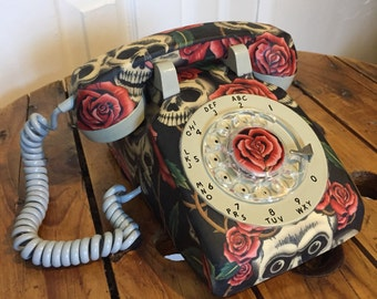 Old phone to dial vintage, old phone to retro antique roulette table beige and black with skulls fabric