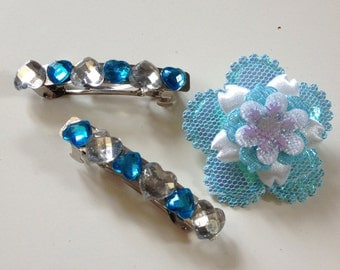 Blue and white jewelled hairclips and matching flower brooch