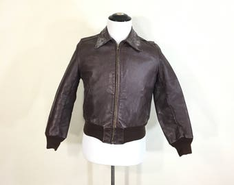 60's 70's vintage leather bomber type  jacket quilt lined