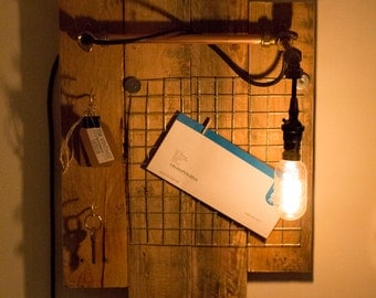 Vintage reclaimed pallet notice board with copper pipe lamp