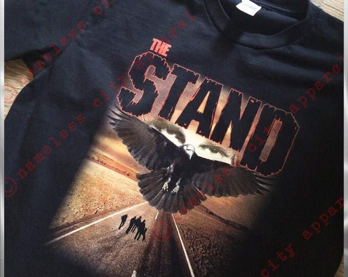 The Stand - The Dark Man - Randall Flagg watches at Nameless City Apparel  - Stephen King's horror novel gets a new shirt! unisex fit