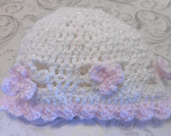 Nice cap for babies, 6-12 months. Several colors and styles available. Knitted by hand. Keep warm your little girl or boy.