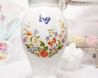 """A large  Aynsley """"Cottage Garden""""  vase: English bone china vase, decorated with beautiful English cottage garden flowers."""
