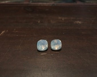 10mm white opal swarovski cushion cut earrings on surgical steel posts. Hypoallergenic