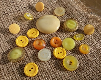 set of yellow vintage buttons