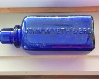 Vintage cobalt blue Milk of Magnesia embossed bottle