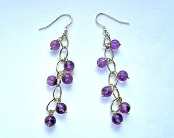 Long sterling silver waterfall earrings with amethyst