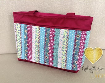 Small pink, green, blue jelly roll bag. Handmade with embroidery. Suitable for everyday wear. Great gift. Made in Scotland.