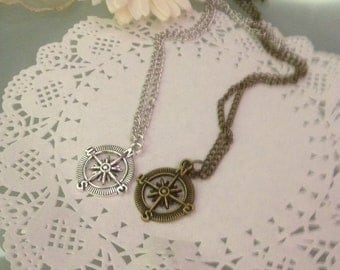 Silver or bronze necklace with pendant compass