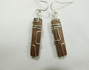 Wooden and silver wire drop earrings with sterling ear wires.