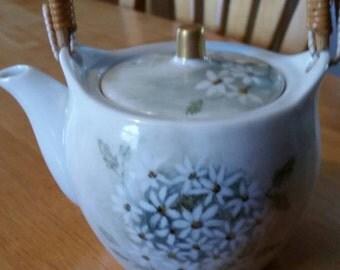 Small vintage porcelain teapot