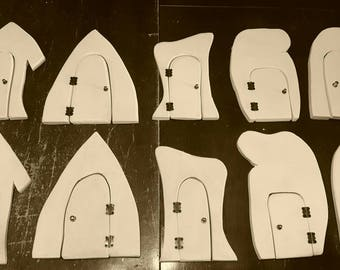 Unpainted  opening fairy doors lot