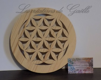 Below of dish wooden, flower of life.