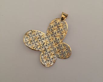 Butterfly shaped pendant in white and yellow 18k gold.