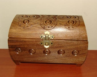 Small box of hand carved wood.