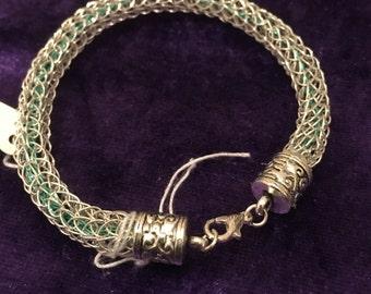 Sterling silver viking knit bracelet woth blue core