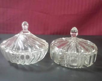 Clear glass candy dishes, with lids.  Buyer's choice,