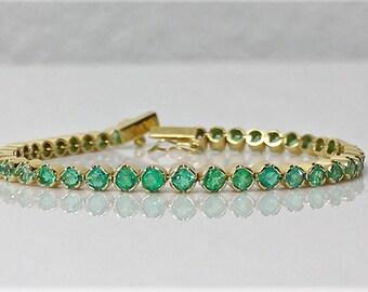Emeralds  tennis bracelet 18Kt Yellow Gold  39 Colombian Emeralds  tennis bracelet . FGAA  NCJV certified RRV 27600 aud