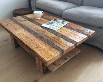 Coffee table made from recycled wood and sea pebbles