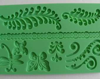 Plate silicone at leaves and butterflies sugar & almond dough moulding