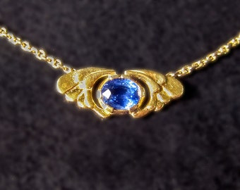 Winged Sapphire 18kt gold winged sapphire pendent