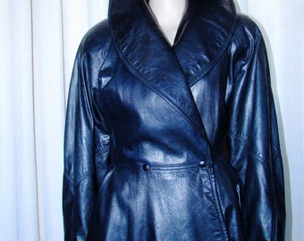 vintage superbe sophistiqué jacket de cur noir Danier/ vintage black sophisticated  leather jacket Danier  size small