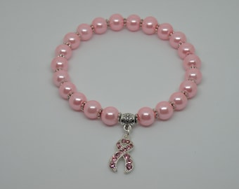 Breast cancer, pink glass pearl stretchy bracelet with a beautiful pink rhinestone ribbon.