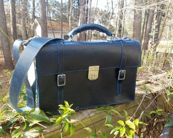 Double strap locking briefcase