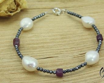 Bracelet from Hematite with freshwater pearls and purple corundum