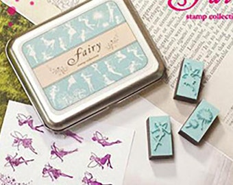 "Stamps 12 piece set, small stamps in Tin box ""fairy"""