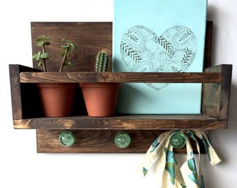 Wooden shelf with glass knobs