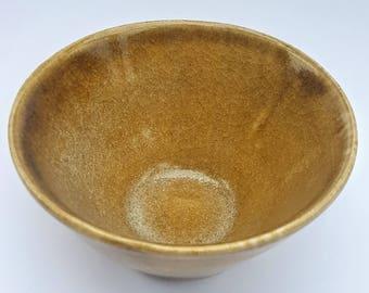 A small hand thrown stoneware bowl.