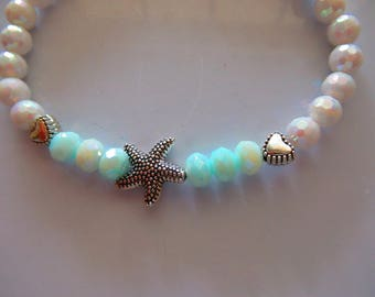 Blue And White Iridescent Multifaceted Beads With Silver Starfish And Hearts Charms Bracelet by FrenchMermaidInLA