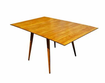 Paul McCobb Planner Group drop-leaf dining table of solid maple