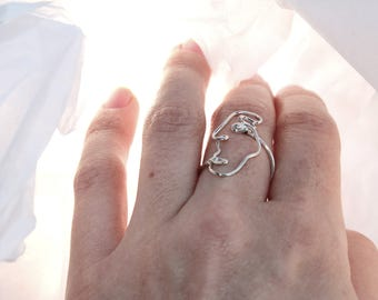 Silver ring with face