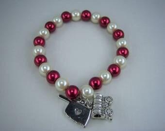 B294, Crimson and Cream Glass Pearls with Oklahoma and Schooner Charm Bracelet