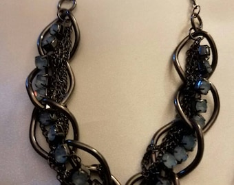 """19"""" Black Chain Necklace with light blue settings."""