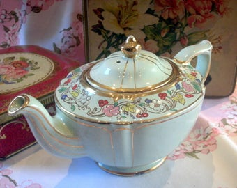 Beautiful mint green teapot by Sadler with lots of handpainted floral detail, c.1940's.