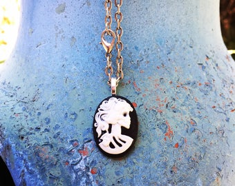 Black skull skeleton cameo pendant on silver tone chain!