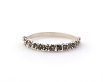 Micro Flower Half Eternity Band in Sterling Silver