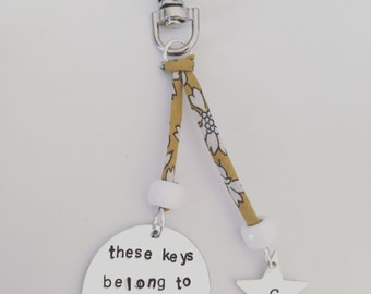 Personalised handstamped liberty London keyring circle tag and star can be personalised with any message