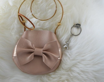 Tan with gold bow purse!