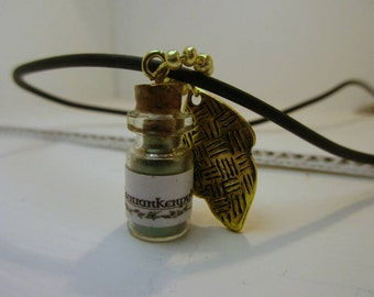 Glass vial on a leather strap, potion ingredients - fairy tendrils powder