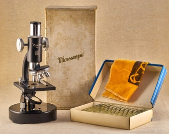 Vintage learning microscope - Vixsen P5. Vintage scientific equipment with box of prepared slides. From 80-s, Japan.