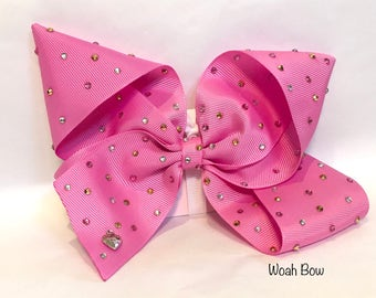 Large pink sparkly hair bow by woah bow. Similar Style To bow worn by Jojo siwa at kids choice awards