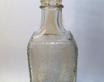 Old antique trademark medicine bottle with sprinkle pattern