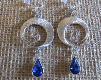 Silver round earrings with decorated circles in middle with blue charms