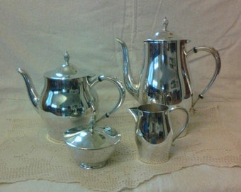 Silver Coffee Pot, Tea Pot, Creamer, and Sugar Bowl